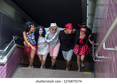 Carnaval party. Dressed group of Brazil people going to street Carnival. Happy brazilian partygoers in costume having fun in parade festival.