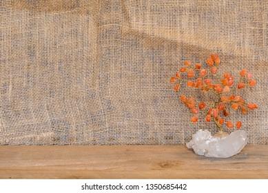 Carnelian Agate gemstone wrapped wire tree against burlap