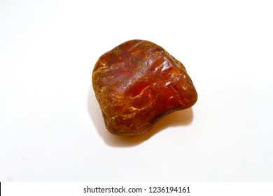 Carnelian stone, orange gemstone 3rd Chakra reiki healing meditation. Natural stone on white background warm light tone.