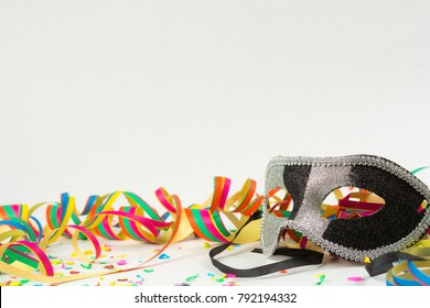 Carneval background with mask, confetti and garland