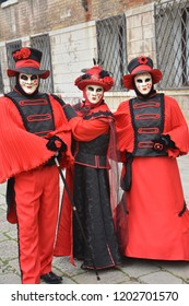 Carneval in Venice. Three red masks.