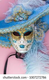 Carnival beautiful venetian mask on pink background.