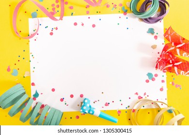 carnival confetti and ribbons on white paper.