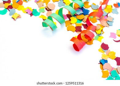 Carnival confetti streamers isolated on white background