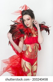 Carnival costume-fire with the elements of body art
