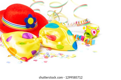 Carnival decoration with carnival hat, bow tie, confetti