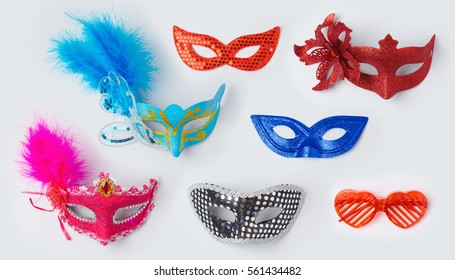 Carnival or mardi gras masks on white background for mock up template design. View from above. Flat lay