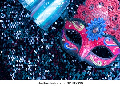 Carnival mask in black shiny background with two glasses and copy space