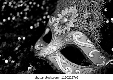 Carnival mask in black and white background with copy space