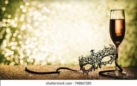carnival mask and champagne with copy space on glittering background