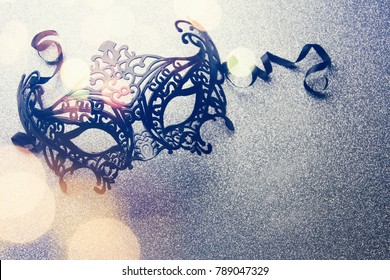 Carnival mask with glittering background.