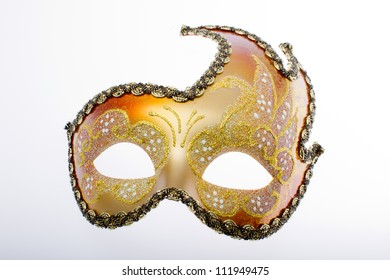Carnival mask in gold and red