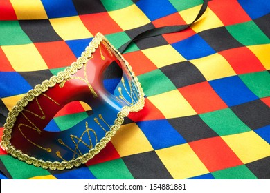 Carnival mask on harlequin costume