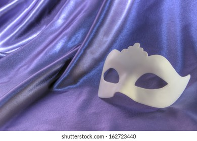 Carnival mask white unisex against the background blue theater