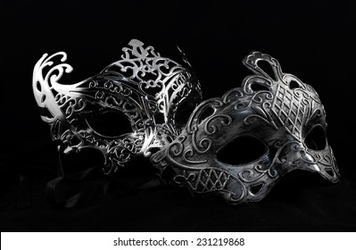 Carnival masks. Holiday carnival masks laying on black background.