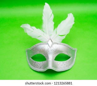 Carnival masks isolated on the green background