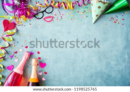 carnival or new years border background with colorful streamers party hats confetti accessories
