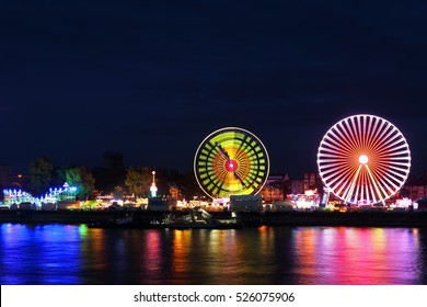 carnival at night with a ferris wheel