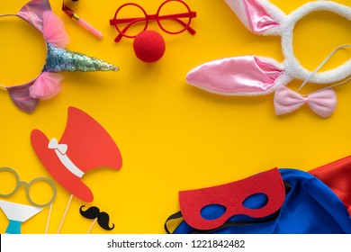 carnival party celebration concept. Top view. Accessories attributes for New Year's masquerade - masks and costumes for children's holiday, Christmas tree, masquerade.