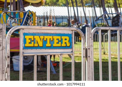 Carnival Ride Entrace Gate with Enter Sign.