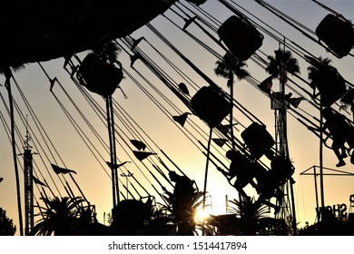 Carnival Ride Wave Swinger Silhouette at Sunset