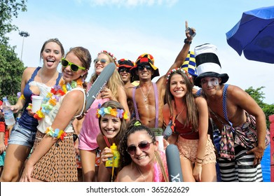 Carnival, Rio de Janeiro, Brazil - March 3, 2014: Friends have tons of fun during the annual block party known as 'Sergeant Pepper'.