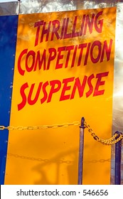 Carnival sign: THRILLING COMPETITION SUSPENSE