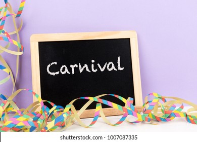 carnival streamer with blackboard with text carnival