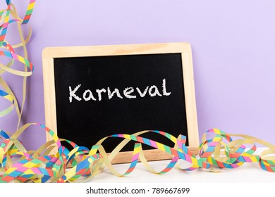 carnival streamer with blackboard with text Karneval (German for