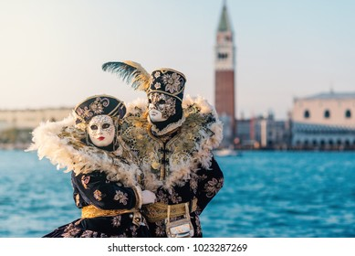 Carnival of Venice, beautiful mask at St. George island with Mark's Square in the background.