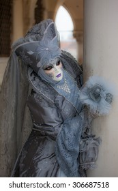 Carnival at Venice. Colorful costumes.The beautiful gray.