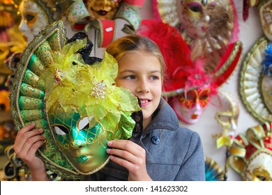 Carnival in Venice, Italy. Portrait of beautiful girl with venetian mask.