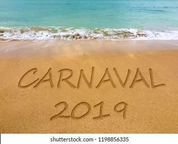 Carnival written in the sand on a beautiful Brazilian beach (translation portuguese: carnival).