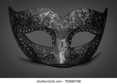 Carnivale mask on a gray background.