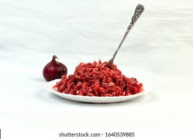 Carnivore diet. Raw ground beef lies on a plate. Minced meat. Conception carnivor.