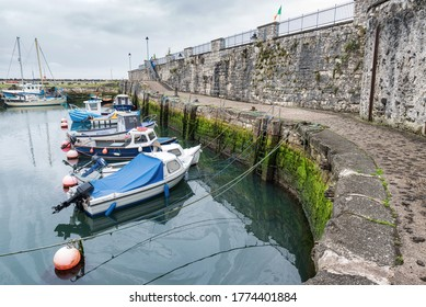 Carnlough, Northern Ireland- July 4, 2020: Fishing boats in Carnlough Harbor on the Antrim Coast in Northern Ireland