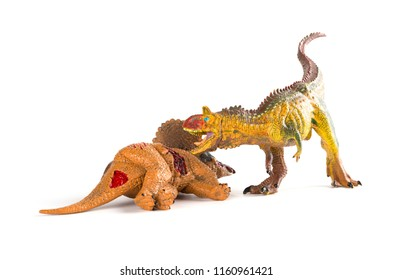 Carnotaurus with a triceratops body nearby on white background