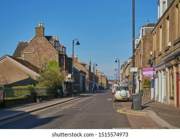 Carnoustie, Scotland - 1st May 2018: Looking down Carnoustie Town High Street on an Early Sunday morning in May. Carnoustie, Angus, Scotland.