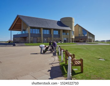 Carnoustie, Scotland - 30th April 2018: Golfers getting ready to play in front of the New Carnoustie Golf centre and Clubhouse, at the Open Championship Course at Carnoustie Links, Angus, Scotland.