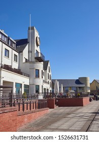 Carnoustie, Scotland - 30th April 2018: Looking up the terrace at the rear of the Carnoustie Golf Hotel at Carnoustie Golf Links, with Golfers sitting down enjoying a drink. Angus,