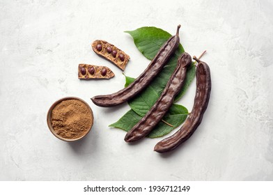 Carob beans and powder. Healthy organic cacao substitute