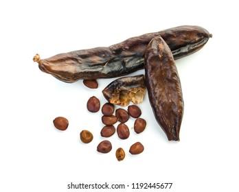 Carob on white background. Carob pods and seeds