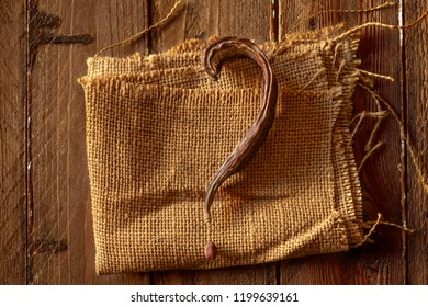 Carob Pod with Question Mark Shape on Jute