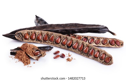 Carob pods, bean and carob powder isolated on white background.