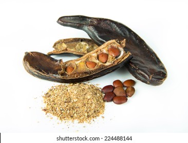 Carob pods and grains isolated on white background