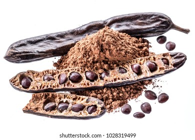 Carob pods and carob powder on the white background.