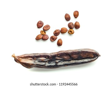 Carob pods with seeds on white background