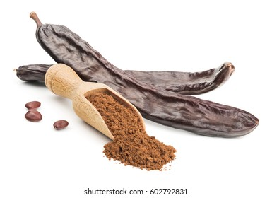 Carob powder and pods isolated on white