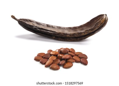 Carobs pod with beans isolated on white background