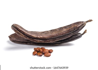 Carobs pods with beans isolated on white background